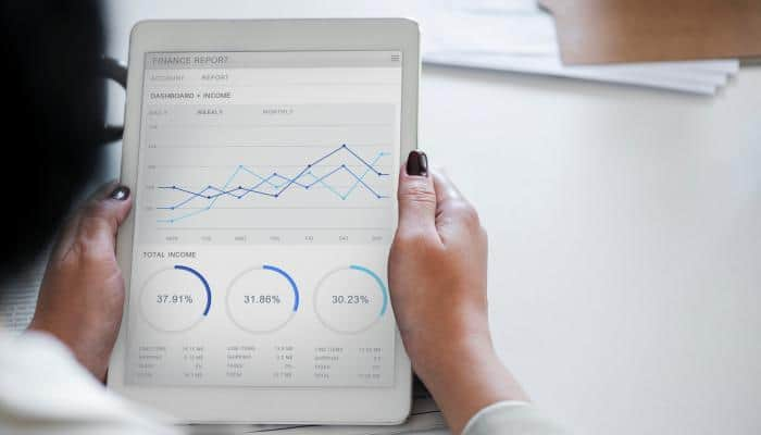 woman reading graph on tablet