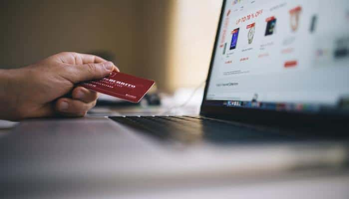 Woman doing online shopping with credit card